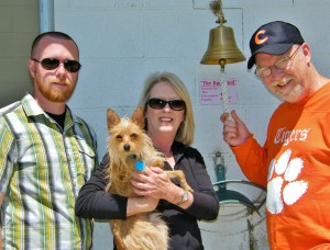 "Pictured left to right, Todd Waldrep, Beth Dettmann, holding adoptable dog ""Zack,"" and Rick Dettmann"